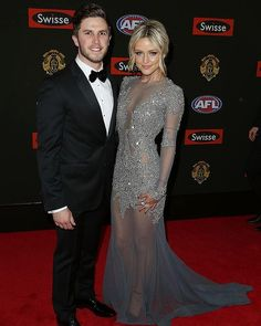 #MarcMurphy of the #CarltonBlues and #JessieHabermann pose on the red carpet for the 2014 AFL #Brownlow Medal.