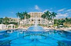 Grand Wailea in Maui   perfect beach, amazing pools! Also home of the one-and-only water elevator to get to the top of the water slides.