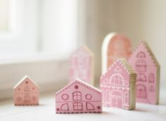 These hand-painted wooden houses inspired imagination (and look just fine when scattered all over the floor).