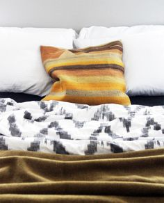 kilim pillow, welt elm duvet, and army surplus blanket at the brick house (buy the duvet here: http://www.westelm.com/products/3802931/?catalogId=27&bnrid=3980901)