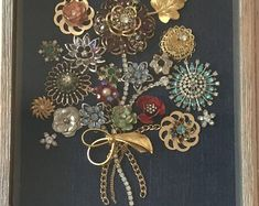A dazzling array of vintage costume jewelry upcycled into beautiful framed bouqu. - A dazzling array of vintage costume jewelry upcycled into beautiful framed bouquet. Costume Jewelry Crafts, Vintage Jewelry Crafts, Vintage Costume Jewelry, Vintage Costumes, Jewelry Christmas Tree, Jewelry Tree, Fine Jewelry, Jewelry Mirror, Jewellery Rings