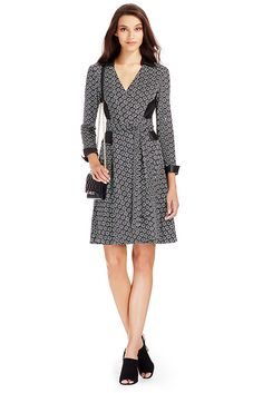 The DVF Rosie is new for the Pre-Fall season, with leather panels that add a flattering edge to our classic silk jersey wrap. True wrap style with collar and cuffs. Falls to above the knee. Fit is true to size.