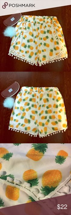 Pineapple pom pom shorts Super fun pineapple shorts. White background with pineapple print. Adorned with white pom poms. Waist band is stretchy. Fits sz medium to large. Tagged large but runs small. Super soft fabric. Perfect condition. Never worn! Not Kate ♠️! kate spade Shorts