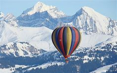 Gstaad, Switzerland  For a winter hot air balloon ride over the Swiss Alps, with views of the surrounding Bernese Oberland, head to Gstaad. During the last week of every January, the International Balloon Festival in Chateau d'Oex takes place and several brightly-coloured balloons from all over the world fill the skies. Alphine Ballooning (www.alpine-ballooning.com) offers both summer and winter balloon rides.
