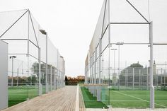 Image 22 of 30 from gallery of The Helios Swimming Centre's General Services Building / ACXT. Courtesy of ACXT Arquitectos Football Stadiums, Football Field, Training Center, Reading Room, Facade, Swimming, Sports Court, Gallery, Soccer Sports