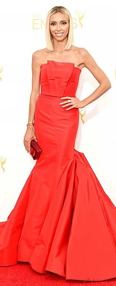 Giuliana Rancic wore a fitted red gown with folded detail at the neck and a voluminous skirt at the 2014 Emmys.