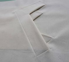 Double angled pocket detail; innovative pattern cutting; creative sewing idea