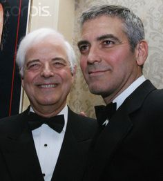 George Clooney (R) stands alongside his father Nick Clooney as they mingle at the White House Correspondents' Dinner in Washington. April 29, 2006