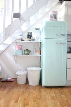 55 Amazing space-saving kitchens under the stairs- looking at all these and just- NO!!! How stupid can one get having open stairs over a kitchen!? I would however love a fridge like this- one day...
