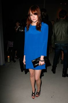 Pin for Later: 79 Big Reasons to Celebrate Emma Stone's Style  No-fail cocktail wear: a body-grazing shift in a major hue.