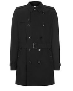 Burberry London Britton Double-Breasted Trench Coat Throat latch Buttoned epaulettes and gun flap Double-breasted button closure Belted waist 2 front buttoned pockets Storm flap and rain shield Checked undercollar and lining Pure cotton Dry clean http://www.harrods.com/product/britton-double-breasted-trench-coat/burberry-london/000000000001881664?cat1=new-men&cat2=ns-coats-jackets