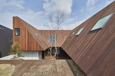 """Completed in 2016 in Gifu, Japan. Images by APERTOZERO. By the client words """"court yard"""" and """"having a picnic in the house"""", they have been guided plant a big tree at courtyard and architecture figure and..."""