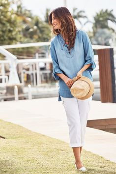 With a washed-denim look, casual roll-tab sleeves and lace-up detailing at the V-neck, this laidback design is super chic.