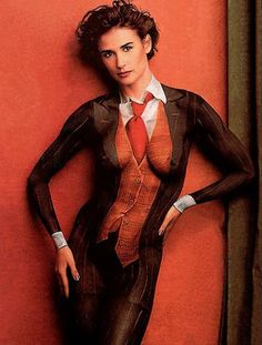 Demi Moore in the iconic painted suit. Shot by Annie Liebovitz.