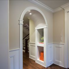 Arched Walk-Through / Built-In Shelves .