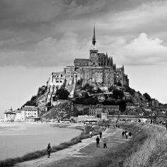 Mont Saint Michel in France  In 5th grade French class we learned new vocabulary from an old B+W movie with a French family driving to this local. Since then I have wanted to go there.