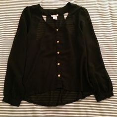 Black Top with Cut Out Back Sheer black top with cut out racer back detail and gold buttons. Like new condition. Purchased at TJ Maxx. 20% off bundles! Dizzy Lizzy Tops Blouses
