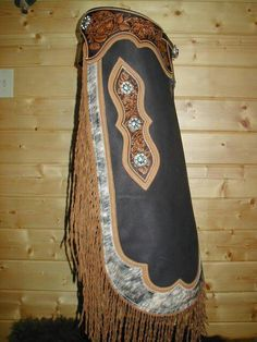 Hair on cowhide with tooling I have a pair of chinks like these only the whole chink is cowhide with tooling around the waist and down the conchos. Very nice chinks...