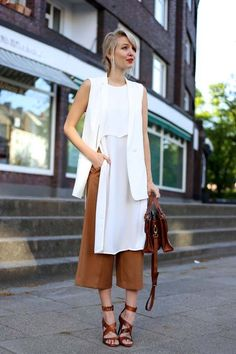 long tunic with a tailored vest, culottes and leather sandals