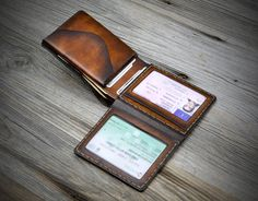 Coin Pocket  ID Window Leather Wallet for men. Bifold by Odorizzi