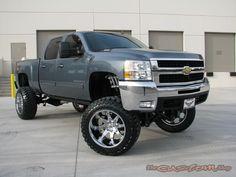 Lifted Blue Chevrolet Silverado truck