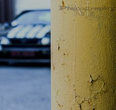 My car near some old factory by school.