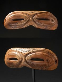 Iniut snow goggles made of walrus ivory.  These goggles were made to reduce the glare while out hunting on the ice and snow. They are a great example of not only native American ingenuity but native american art. #tribal art #ethnographic art #native american #native canadian