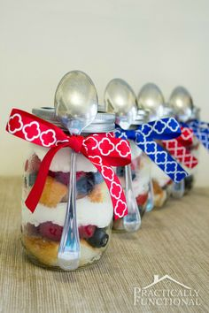 Red, white, and blue Fourth Of July picnic dessert: Strawberry blueberry trifle! Serve trifle in mason jars to get easy individual servings. Just tie a spoon to the jar with a ribbon, and serve!