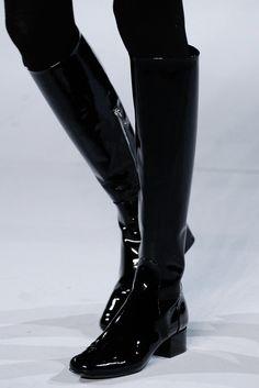 some sleek shiny boots