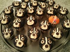 Bernese Mountain Dog Cupcakes! Made with black sugar, white frosting, chocolate chips for nose and eyes and caramel sauce for the browns. Yum! (Picture only)