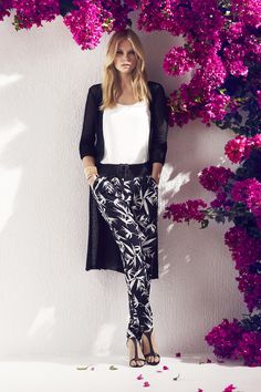 A tropical print delivers a playful finish to these slouchy, slim leg pull-on pants cut from lightweight fabric. #palmtree