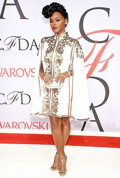 Janelle Monae accessorized her embellished cape-dress with a gold-lined Edie Parker clutch and diamond baubles.