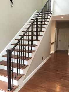Handmade spindles & newel posts with hidden hardware. Staircase Metal, Wrought Iron Stair Railing, Stairs And Staircase, Stair Railing Design, Iron Balusters, Home Stairs Design, Staircase Remodel, Wood Stairs, Stairway