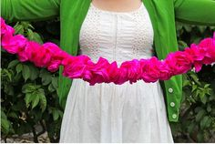 DIY: Crepe Paper Flower Garland - Cut 3″ circles out of crepe paper. Layer three circles on top of each other, fold in half and twist in the middle so they stay connected together. Carefully poof the layers of paper to make a flower look. Use a needle and thread to string together. *EASY*