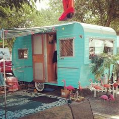 Cute turquoise caravan with flamingoes | tiny trailer - vintage camper <O>