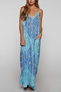 6cee1ebfd2b3 This sleeveless v-neckline maxi dress has a palm leaf printed design with a  gathered cocoon like fit and side pockets