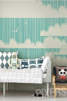 Simple single-tone kids mural with clouds, birds, and asymetric stripes