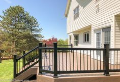 Lowe's Composite Deck by Tropics is a beautiful low-maintenance product that is easy to install. See our beautiful new tropics deck and instructions how to install yours! Aluminum Decking, Laying Decking, Bay Window Curtains, Deck Posts, Tropical Bathroom, Diy Deck, Composite Decking, Building A Deck, Deck Design