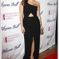 Black one shoulder BCBG dress with cut outs. Long black one shoulder BCBG dress, never worn. Beautiful cut outs. BCBG Dresses