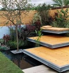 Wakimoto side yard deck platforms...I like the idea of framing them with steel. My Home Ideas