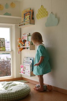 Clever reading nook idea: Buy spice racks super cheap and paint, use as book shelves