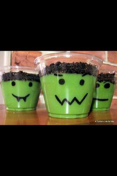 Draw a face on a clear cup; add green food coloring to vanilla pudding and crush Oreos on top !!!