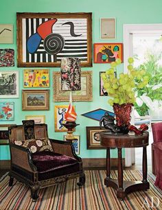 In the São Paulo living room of architect and interior designer Sig Bergamin and his partner, architect Maurilo Lomas, works by Alexander Calder, Carla Barth, and others hangs behind a chinoiserie chair cushioned with a Rubelli velvet.