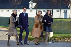 Members of the Danish, Greek, Berleberg and Sayn-Wittgenstein royal families make their way to the Chancellery House in Fredensborg Palace on Christmas 2014