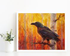 Inspired by the artist's time living in Alaska, this painting features a captivating Raven, perched on the branch of a birch tree in autumn. These wise birds are known for their intelligence and complex social behaviors. This print comes loose, or packaged with a crisp white mat, in a protective sleeve. It is available in various sizes, ready to grace your wall with vibrant colors and hues. Made in the USA