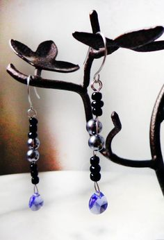 Hand Made earrings with Genuine Swarovksi Tanzanite crystal and grey pearls with Black Glass Beads.    This Item is ready for shipping. It will be in a crochet white or red little pouch for gift!  Please specify the color when you make your purchase or it will be my choice.    perfect for those who are allergic to Metals, even if you are not allergic to metals but your ears get irritated, stainless steel is perfect