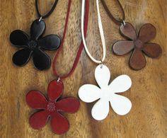 Leather flower pendants.