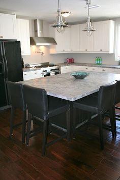 My kitchen - Moon Night Quartzite, Ikea cabinets, Garrison wood flooring and Bertazzoni range/hood