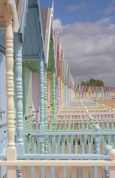 Beach Huts - Mersea Island, Essex, England - These are too pastel for me, as I would like bold blue & white or red & white - but I LOVE this photo. Beach Huts look so much better when there is a long row of them, but I only have room for 1 in my garden x The Places Youll Go, Places To Go, Beach Cottages, Beach Huts, Pretty Pastel, Pastel Colors, Colours, Pastel Palette, Pastel Yellow