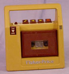 Fisher Price cassette tape recorder.  I think mine was brown.  I have recordings from this little machine from as young as 5 years old I think!